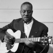 Big Bill Broonzy perfoms at the Folkways Records studio in New York City, 1958