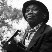 Mississippi John Hurt performs at the Newport Folk Festival in July 1964