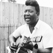 Muddy Waters performs at the Newport Folk Festival in July 1967