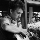 Bob Dylan performs at the Newport Folk Festival in July 1963