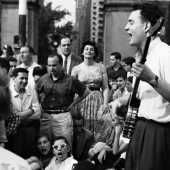 Folk Revival: Hootenany in Washington Square Park, 1959. The performer is Dave Sear, legendary member of the folk music community since the 1940s and host of Public Radio\'s Folk Music Almanac for 35 years.