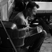 Portrait of Pete Seeger at his log cabin home in Beacon, New York, August 1958