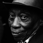 Portrait of Mississippi John Hurt at the Newport Folk Festival in July 1964