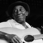 Mississippi John Hurt performs at the Newport Folk Festival in July 1963