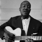 Big Bill Broonzy (William Lee Conley), records in the studios of Folkways Records in 1958 in New York City.
