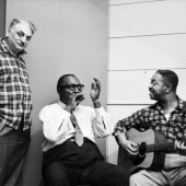 Moe Asch (L) , the founder of Folkways Records, with blues harpist Sonny Terry and blues singer and guitarist Brownie McGhee at the Folkways Records studios in 1958 in New York City