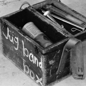Folk Portrait: A Jug Band Box, to store kazoos, spoons, tissue and comb, and a pennywhistle, for the Jim Kweskin Jug Band at the Newport Folk Festival in July 1964
