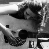 Folk Portrait: Young Woman with Guitar, Washington Square Park in New York City, June 1965