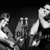 Judy Collins and Theodore Bikel perform at the Newport Folk Festival in Juuly 1963