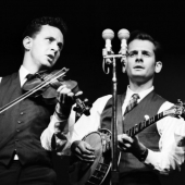 New Lost City Ramblers perform at the Newport Folk Festival in July 1959: Tracy Schwartz, Mike Seeger, and John Cohen